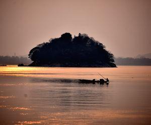 Fishermen Head Back Home As The Sun Sets