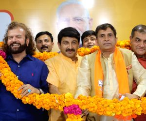 Former AAP leader Vijender Yadav joins BJP in the presence of Delhi party President Manoj Tiwari and the party's newly elected MP from North West Delhi, Hans Raj Hans at the BJP ...