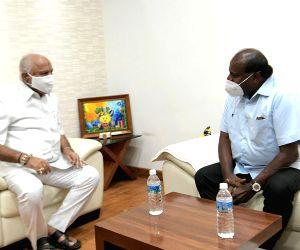 Former CM HD Kumaraswamy meets Chief Minister of Karnataka BS Yediyurappa, in Bengaluru.