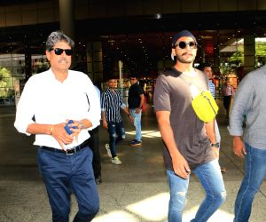 Former cricketer Kapil Dev and actor Ranveer Singh. (Photo: IANS)