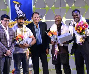 Former cricketers Sourav Ganguly, Mohammad Azharuddin, Brian Lara, and Carl Hooper with Indian cricketer Rohit Sharma during Jagmohan Dalmiya Annual Conclave in Kolkata on Nov 2, 2018.