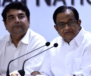 Former Finance Minister and Congress leader P Chidambaram addresses a press conference at All India Congress Committee office in New Delhi on Sept 27, 2017. Also seen Congress leader R. P. ...