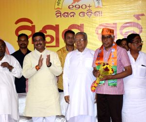 Former Odisha DGP Prakash Mishra joins Bharatiya Janata Party (BJP) in the presence of Union Minister and party leader Dharmendra Pradhan in Bhubaneswar on March 24, 2019.