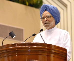 """Former Prime Minister Manmohan Singh addresses at the launch of """"Moving On... Moving Forward: A Year In Office"""" - a book marking the completion of Naidu's one year as the Vice ..."""