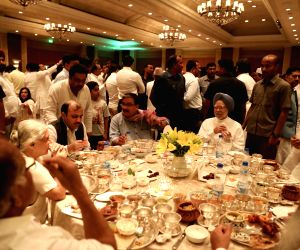 Former Prime Minister Manmohan Singh, Loktantrik Janata Dal leader Sharad Yadav, RJD leader Manoj Jha and others at the iftaar party hosted by Congress President Rahul Gandhi in New Delhi ...