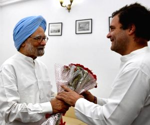 Former Prime Minister Manmohan Singh wishes Congress President Rahul Gandhi on his birthday, in New Delhi, on June 19, 2019.