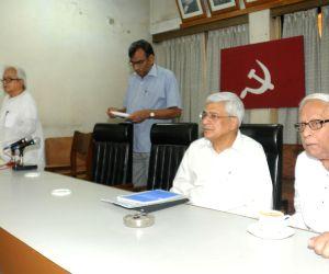 Prakash Karat,Buddhadeb Bhattacharjee during CPI(M) meeting
