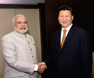 Chinese President Xi Jinping meets with Indian Prime Minister Narendra Modi in Fortaleza, Brazil