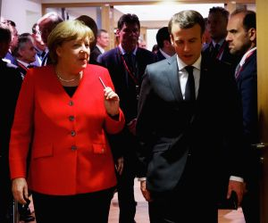 French President Emmanuel Macron (R, Front) and German Chancellor Angela Merkel (L). (Xinhua/European Union/IANS)