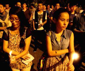 Candlelight vigil for Akha Salouni