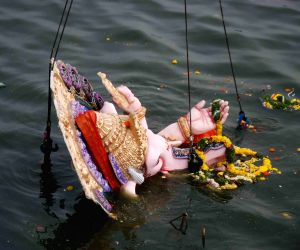 Debris from the Hussain Sagar lake removed post Ganesh immersion