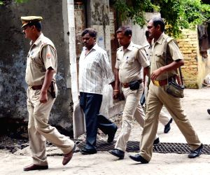 Ghaziabad: Nithari killings' convict Surender Koli being taken to be produced before a CBI court in Ghaziabad on July 29, 2015. (Photo: IANS)