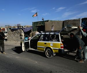 GHAZNI, Nov. 7, 2018 - An Afghan policeman checks a vehicle at a security checkpoint on the way leading to Jaghori district in Ghazni province, Afghanistan, Nov. 7, 2018. Three police have been ...