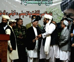 GHAZNI, Sept. 27, 2018 - Afghan President Mohammad Ashraf Ghani (C) shakes hands with people in Ghazni city, capital of Ghazni province, Afghanistan, Sept. 27, 2018. Three rockets fired by Taliban ...