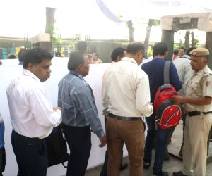 Government employees appointed for election duty in the forthcoming Lok Sabha elections queue up to collect their appointment letters ahead of polls, in New Delhi on May 11, 2019.