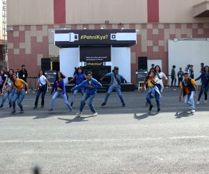 """Greater Noida: Dancers participate during Maruti Suzuki's invites vehicle occupants to take the pledge and wear seatbelts during """"#PehniKya Flash Mob"""" campaign at the Auto Expo 2018 in ..."""
