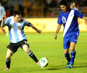 Lionel Messi celebrates during a friendly soccer match against Guatemala