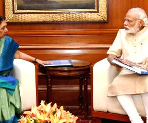 Gujarat CM calls on Modi