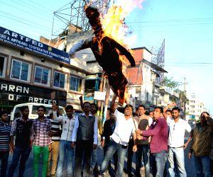 Asom Yuva Parishad activists bur Modi effigies