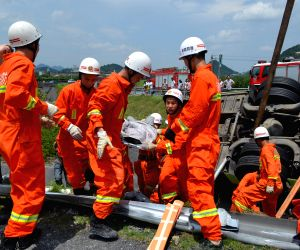 Rescuers work on the scene of a passenger coach rollover accident along the Hangzhou-Huizhou highway in Hangzhou