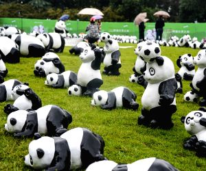 Panda figures are displayed on a lawn