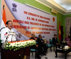 Hanoi: Vice President M. Venkaiah Naidu addresses at the presentation ceremony of Jaipur Foot Artificial Limb Fitments under the 'India for Humanity' programme to commemorate 150 years of Mahatma Gandhi at Ho Chi Minh Hall, Embassy of India in Hanoi,