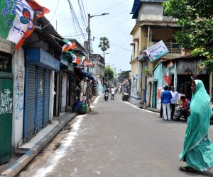 Harish Chatterjee Road near West Bengal Chief Minister and TMC supremo Mamata Banerjee's residence bears a deserted look after the counting trends show that BJP led NDA appeared set to ...