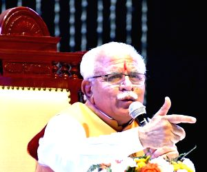 Khattar addresses during a programme