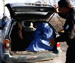 HERAT, Feb. 24, 2019 - An Afghan policeman searches a vehicle at a security checkpoint along Herat-Farah main road in Herat, Afghanistan, Feb. 24, 2019. Afghan security forces have killed nine ...