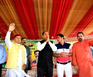Himachal Pradesh Chief Minister Jai Ram Thakur and Former Chief Minister Prem Kumar Dhumal during BJP's public rally at Chowki in Sujanpur Assembly constituency of Hamirpur district of ...
