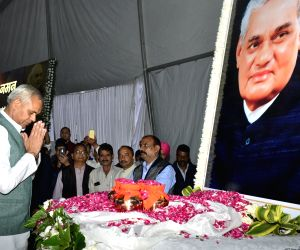 Himachal Pradesh former Chief Minister Prem Kumar Dhumal pays tribute during a prayer meeting organised in the memory of former Prime Minister Late Atal Bihari Vajpayee, in Shimla, on  Aug ...