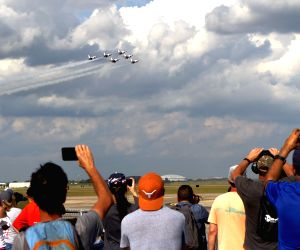 HOUSTON, Oct. 20, 2019 - Visitors watch aerobatic performance by the U.S. Air Force Thunderbirds during the annual Wings Over Houston Airshow at the Ellington Airport in the U.S. state of Texas on ...