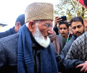 Hurriyat Conference (G) chairman Syed Ali Geelani arrives to participate in the funeral prayers of his late son-in-law Ghulam Hassan Makhdoomi in Jammu and Kashmir's Sopore on Nov 15, 2018.