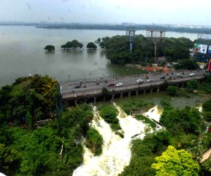 Hyderabad: An overflowing Hussain Sagar Lake along with heavy rains that continue to lash Hyderabad, have left the city inundated, on Sep 25, 2019. (Photo: IANS)