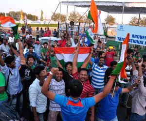 People celebrate India's victory against Pakistan in a World Cup match
