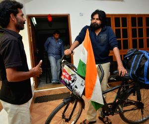 Hero Pavan Kalyans fan Addamki Ravi from Kharagpur of West Benagal traveled by bicycle to meet his hero
