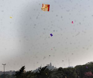People fly kites on Makar Sankranti