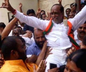 Hyderabad: Telangana BJP President K. Laxman celebrates with party workers after the party led by Prime Minister Narendra Modi was set to retain power for another five years after making a sweep of the Lok Sabha battle and mauling the opposition; in