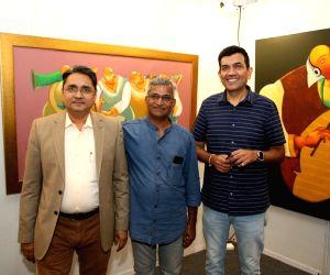 Free Photo: Aditi Rao Hydari admires paintings at India Art Festival