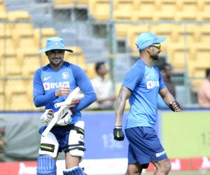 India's Shikhar Dhawan and Manish Pandey during a practice session ahead of the final T20I match against South Africa, at M. Chinnaswamy Stadium in Bengaluru on Sep 21, 2019.