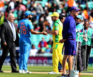 India's Virat Kohli and Australian skipper Aaron Finch during the toss ahead of the match between India and Australia during ICC Cricket World Cup 2019 at the Oval, in Kennington, England ...
