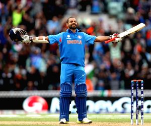 Indian batsman Shikhar Dhawan celebartes after scoring century during ICC Champions Trophy cricket match between India and West Indies at Kennington Oval, London on June 11, 2013.