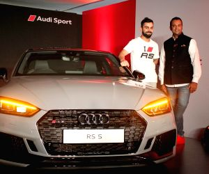 Indian cricket team skipper Virat Kohli and Audi India Head Rahil Ansari at the launch of the second generation Audi RS 5 Coupe in Bengaluru on April 11, 2018.