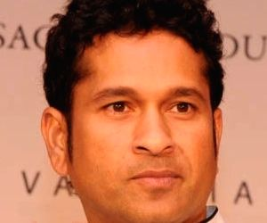 Indian cricketer Sachin Tendulkar and Valuemart Gold & Jewels Ltd  MD C K Vasudevan  during the launch of Gold coin with embossed face of his , launched by Valuemart Gold & Jewels Ltd on ...