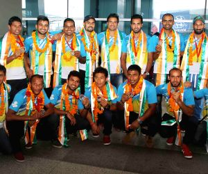 Hockey Team arrives at IGI Airport