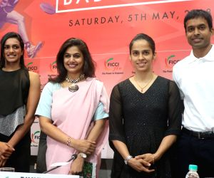 Indian national badminton coach Pullela Gopichand along with players Saina Nehwal, PV Sindhu and Ficci Ladies Organisation (FLO) President Pinky Reddy during a felecitation programme ...
