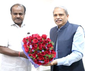 Infosys Executive Vice Chairman, Kris Gopalakrishnan meets Karnataka Chief Minister H. D. Kumaraswamy, in Bengaluru on July 7, 2018.