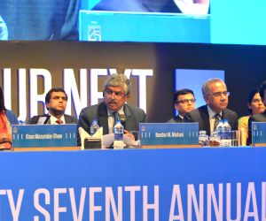 Infosys Non-Executive Chairman Nandan Nilekani, Infosys COO Pravin Rao, Infosys board member Kiran Mazumdar-Shaw and Infosys' chief financial officer (CFO) MD Ranganath at the 37th Annual ...