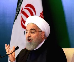 Rouhani urges boost ties with Pakistan under Imran Khan