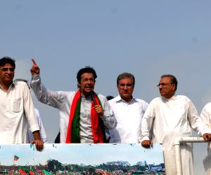 Imran Khan addresses his supporters during a protest